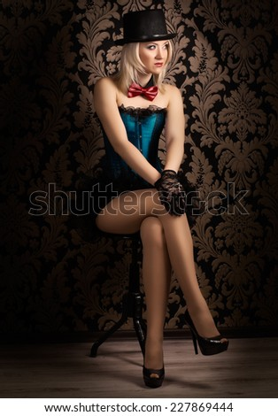 beautiful cabaret woman posing on a chair