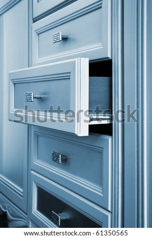beautiful cabinet with drawers in a modern room - stock photo
