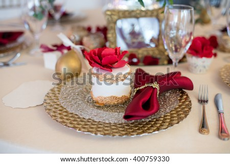 Beautiful cake on a plate and  napkin on festive table