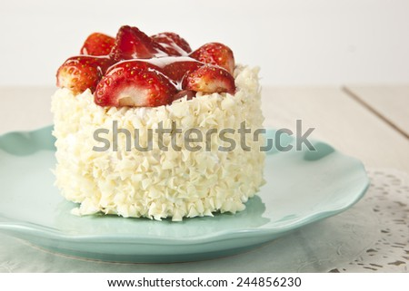 beautiful cake with strawberries and cream - stock photo