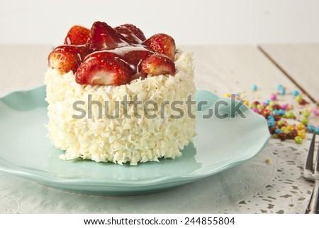 beautiful cake with strawberries , white chocolate and cream - stock photo