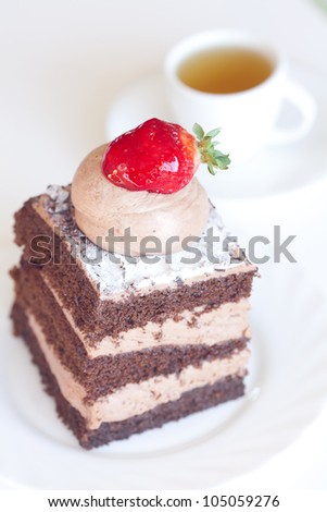 beautiful cake with strawberry and tea on a white background
