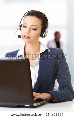 Beautiful call-center assistant at the desk