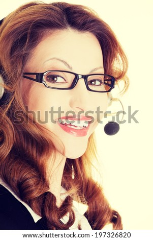 Beautiful call center assistant smiling.