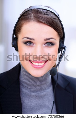 Beautiful call center operator with headset. - stock photo