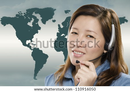 Beautiful call center with global map on background - stock photo