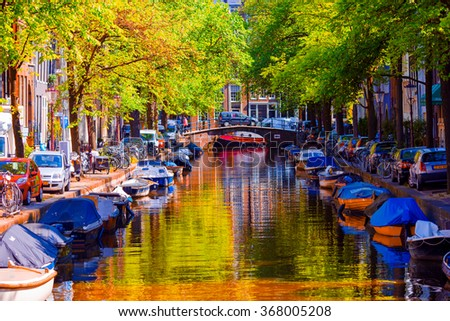 Beautiful canal in the old city of Amsterdam, Netherlands, North Holland province. - stock photo