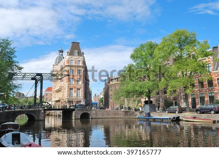 Beautiful canal quay in Amsterdam in a sunny summer day