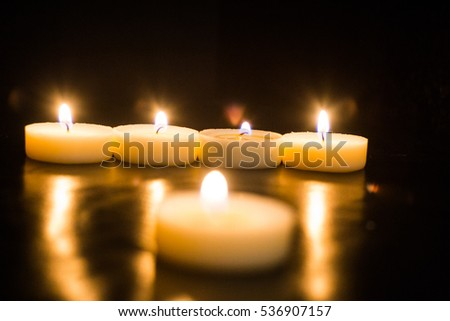 beautiful candles on a black background
