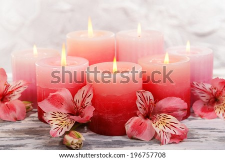 Pink candles stock images royalty free images vectors beautiful candles with flowers on table on grey background sciox Images