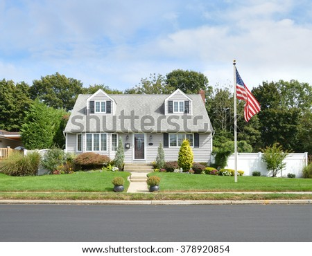 Beautiful Cape Cod Style Home Residential Neighborhood USA blue sky clouds - stock photo