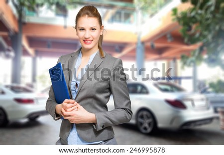 Beautiful car dealer smiling - stock photo