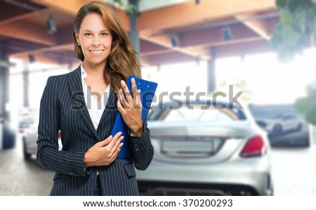 Beautiful car dealer smiling