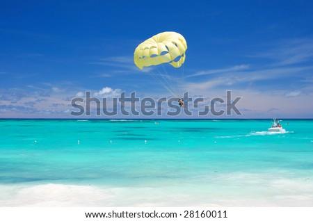 Beautiful caribbean beach in Dominican Republic. Unrecognizable people. - stock photo