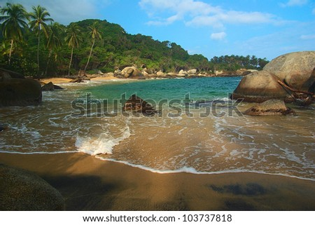 Beautiful Caribbean beach with palm trees in Tayrona National Park close to Santa Marta in Northern Colombia