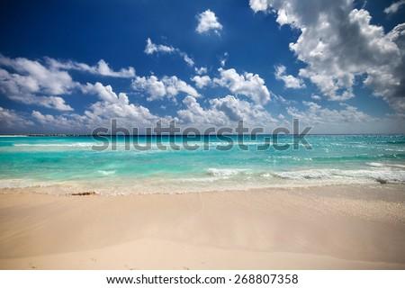 Beautiful caribbean sea beach with turquoise water - stock photo