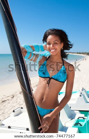 Beautiful caribbean woman  on a topical beach