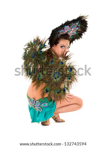 Beautiful carnival dancer woman full length studio portrait isolated on white