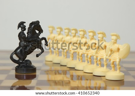beautiful carved chess pieces made of ivory - stock photo