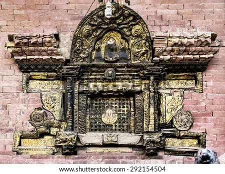 Beautiful carved wooden window at the 9 th century building - Bhaktapur, Nepal, Himalayas - stock photo