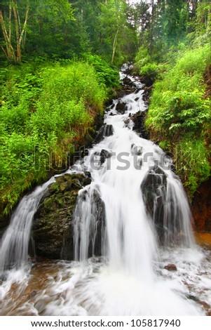 Beautiful cascading waterfall in the Black Hills of South Dakota - stock photo