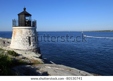 Beautiful Castle Hill lighthouse in Newport, Rhode Island overlooking the Atlantic Ocean, built in 1830 - stock photo