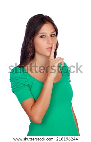 "Beautiful casual girl with a gesture of ""shh"" isolated on a white background - stock photo"
