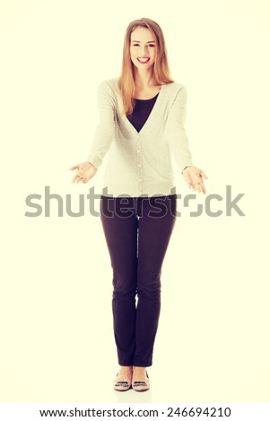 Beautiful casual woman holding copy space on her palms - stock photo