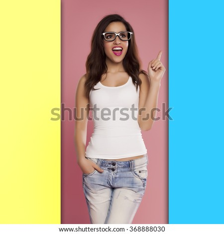 Beautiful casual woman over a colourful background. - stock photo