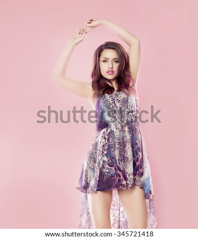Beautiful casual woman over a pink background. - stock photo