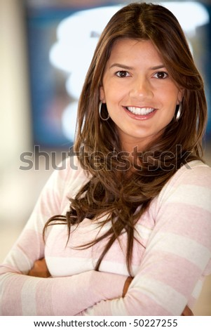 Beautiful casual woman portrait smiling indoors