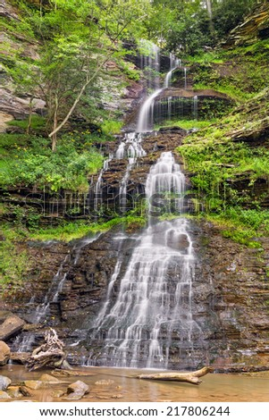 Beautiful Cathedral Falls, is a tall, cascading waterfall in West Virginia's New River Gorge area near the town of Gauley Bridge. - stock photo