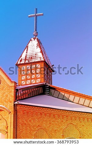 Beautiful Catholic Church photographed closeup on a background of blue sky