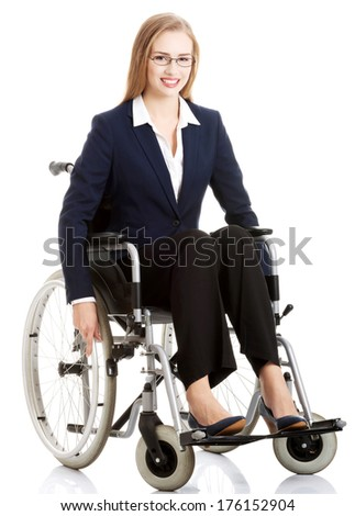 Beautiful caucasain business woman sitting on wheelchair. Isolated on white. - stock photo