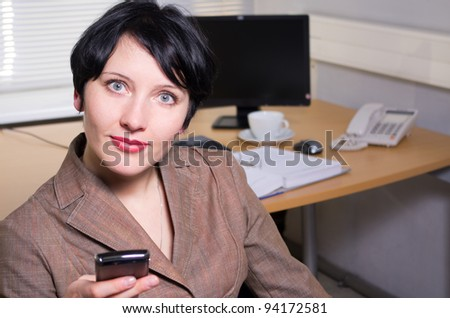 Beautiful caucasian brunette businesswoman in her office.