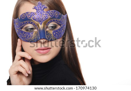 Beautiful caucasian brunette in carnival mask over white background - stock photo