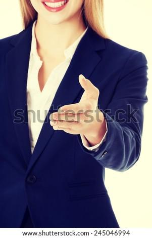 Beautiful caucasian business woman giving a hand.  - stock photo