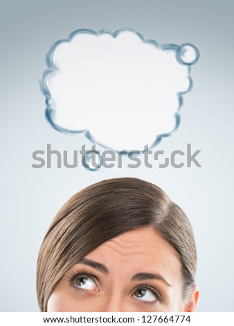 Beautiful caucasian business woman have good idea, including thought bubble with copy space on grey background - stock photo