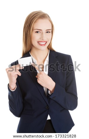 Beautiful caucasian business woman holding personal card. Isolated on white.
