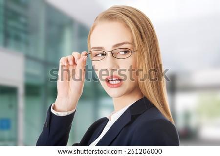 Beautiful caucasian business woman in eyeglasses is looking - stock photo