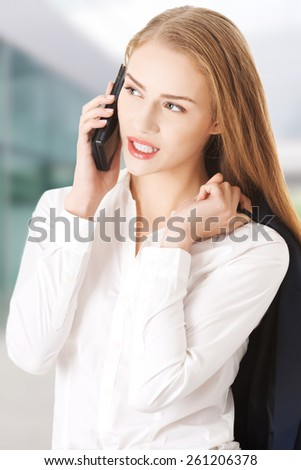 Beautiful caucasian business woman is talking through phone. - stock photo