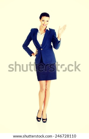 Beautiful caucasian business woman waving her hand.