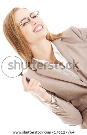 Beautiful caucasian business woman with magnifying glass. Isolated on white. - stock photo