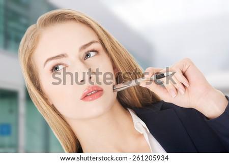 Beautiful caucasian business woman with pen - stock photo