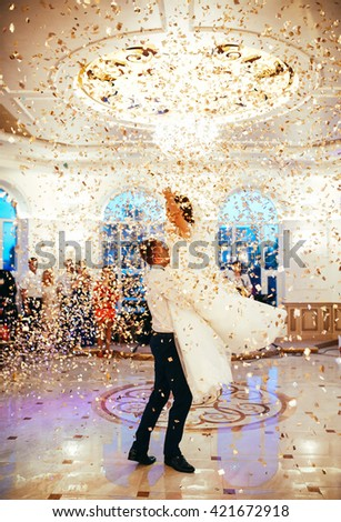 beautiful caucasian couple just married and dancing their first dance - stock photo