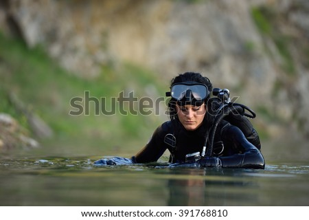 beautiful caucasian diver woman in the water - stock photo