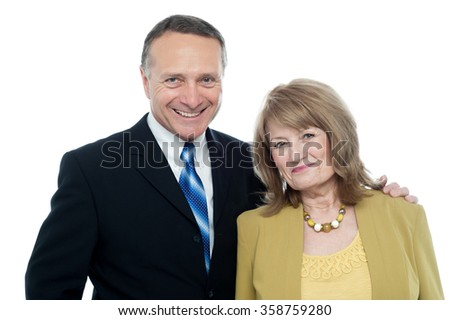 Beautiful caucasian elderly couple over white background - stock photo