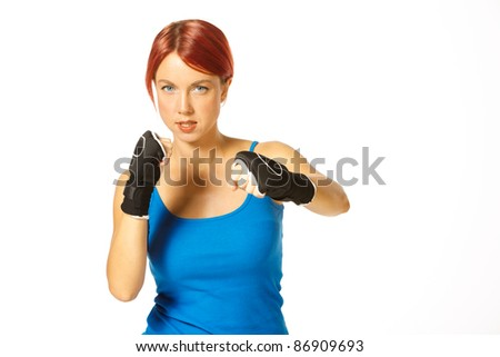 beautiful caucasian female boxer wearing boxing gloves