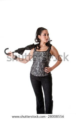 Beautiful caucasian female wearing gray tank top and jeans and hand on hip, carrying unbrella in neck, isolated
