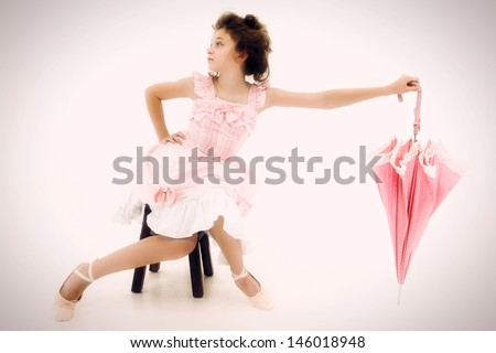 Beautiful Caucasian Girl Child in Pink Lolita Style Fashion with Polka Dot Umbrella - stock photo